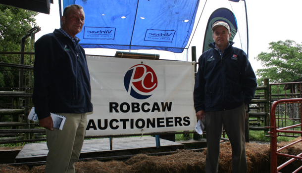 AJ Rob and Gary Cawthorne with the banner of their before staging the Keiroad sale by their newly established auctioneering firm.